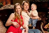 picture of christmas baby  - Happy smiling family near the Christmas tree celebrate New Year - JPG