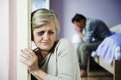 stock photo of dominant woman  - Mature woman with black eye is victim of domestic violence and abuse - JPG