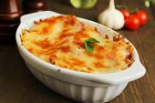 image of lasagna  - Fresh lasagna in a white container with basil - JPG