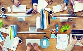 stock photo of tables  - Group of Business People Working on an Office Desk - JPG