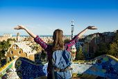 picture of gaudi barcelona  - Rear view of young female tourist enjoying the view in Parc Guell in Barcelona - JPG