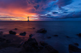 foto of camiguin  - Catholic cross silhouette in a sunken cemetery at dusk - JPG