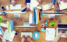 picture of messy  - Group of Business People Working on an Office Desk - JPG