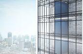 image of baseboard  - big skyscraper on city background - JPG