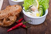 stock photo of dipping  - fresh organic garlic cheese dip salad on a rustic table with bread - JPG