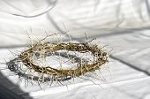 picture of passion christ  - crown of thorns reminds the passion of the christ. resting on a white linen cloth with an olive branch ** Note: Shallow depth of field - JPG