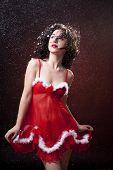 stock photo of voluptuous  - Sexy Santa helper - JPG