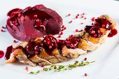 foto of duck breast  - Roasted duck breast with cranberry sauce and vegetables - JPG