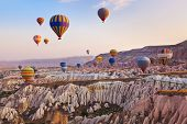 picture of rocking  - Hot air balloon flying over rock landscape at Cappadocia Turkey - JPG