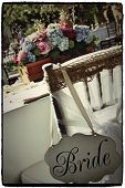 picture of centerpiece  - Chiffon wrapped chiavari wedding chair with bride sign - JPG