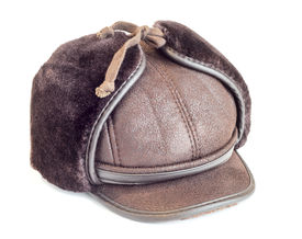 stock photo of budge  - Mens winter cap Leather and furisolated on white - JPG