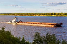 foto of barge  - Old barge floating up the river Northern Dvina - JPG