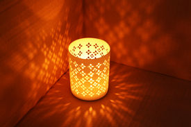 picture of luminaria  - Lantern casts shadows on wall - JPG