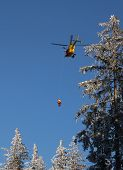 picture of paramedic  - Alpine rescue helicopter in the mountains paramedic saving a badly insured person - JPG