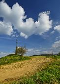 stock photo of calvary  - Spring day with a cloudy sky and calvary - JPG