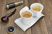 stock photo of spyglass  - Spyglass Compass Smoking Pipe and Two White Espresso Coffee Cups On Grunge Wooden Table - JPG