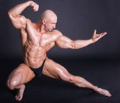 stock photo of arm muscle  - Bodybuilder is posing showing his muscles - JPG