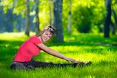 foto of stretching  - Stretching woman in outdoor sport exercise - JPG