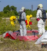 foto of disaster preparedness  - Hazmat team members have been wearing protective suits to protect them from hazardous materials - JPG