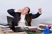 stock photo of boring  - Schoolgirl yawns - JPG