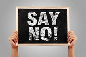 picture of just say no  - Say No blackboard is holden by hands with gray background - JPG