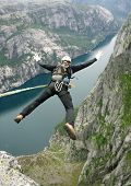 picture of jump rope  - Man jumping off a cliff with a rope - JPG