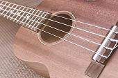 image of ukulele  - Close up of ukulele selective focus with soft light - JPG