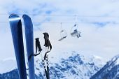 picture of caucus  - Mountain ski with poles with mountain peak and chairlift on background - JPG