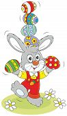 image of juggling  - Little rabbit juggling with colorful Easter eggs - JPG