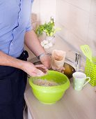 stock photo of mixing faucet  - Close up of man mixing ingredients for healthy bread - JPG