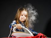 picture of cinderella  - Cute little girl helping your mother by ironing clothes childhood concept - JPG