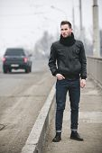 Постер, плакат: Confident Man Posing In Selvedge Jeans