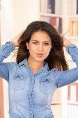 foto of denim wear  - portrait of pretty young brunette wearing denim shirt - JPG
