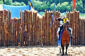 picture of jousting  - armored medieval knight on horseback at jousting competition - JPG