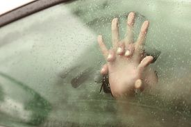 image of intimate  - Couple holding hands having sex inside a car with a steamy window - JPG