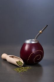 image of calabash  - Calabash and bombilla with yerba mate on gray background - JPG