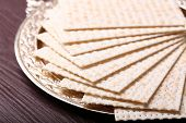 picture of matzah  - Matzo for Passover on metal tray on table close up - JPG
