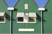 image of gable-roof  - A Dutch house with a triangular gable and and sunscreen on the windows - JPG
