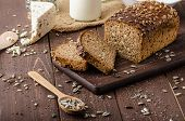 picture of whole-wheat  - Whole wheat bread baked at home bio ingredients very healthy with seeds - JPG