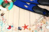 pic of flipper  - Sea composition with flippers and shells on wooden table close up - JPG
