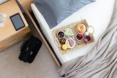 picture of bed breakfast  - High Angle View of Breakfast Tray on Unmade Bed in Hotel Room in Business Trip Concept Image with Black Briefcase Bag and Computer Tablet on Bedside Table - JPG