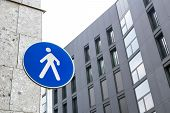 pic of pedestrians  - Road sign pedestrian area between the buildings of the city - JPG