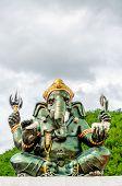 foto of hindu  - Green Ganesha Hindu God statue close up on natural background - JPG