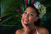 foto of filipina  - Beautiful woman in tropical forest smiling at camera - JPG