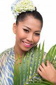 stock photo of filipina  - Beautiful Filipina with flowers in her hair - JPG