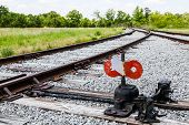stock photo of merge  - An Old railroad tracks merging and switching - JPG