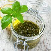 foto of pesto sauce  - Homemade green basil pesto sauce and fresh ingredients - JPG