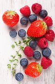 stock photo of berries  - Close up of strawberry and ather berries on White Wooden Background - JPG