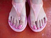 picture of pedicure  - Closeup photo of a beautiful female feet with pink pedicure - JPG