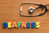 stock photo of deaf  - deafness colorful medical word and stethoscope on the wooden background - JPG